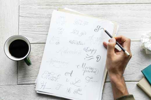 person writing on paper sheet